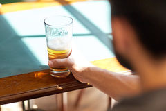 Close up of man drinking beer at bar or pub Royalty Free Stock Photography