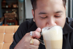 Close up of man drinking coffee Stock Images