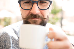 Close up of a man drinking coffee royalty free stock photo