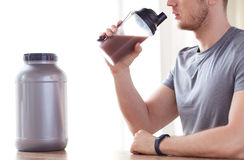 Close up of man drinking protein shake Stock Photos