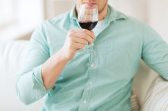Close up of man drinking wine at home Stock Images