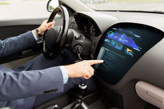 Close up of man driving car with navigation system. Transport, navigation, business trip, modern technology and people concept - close up of man driving car with royalty free stock photos