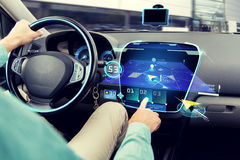 Close up of man driving car with navigation system. Transport, destination, modern technology and people concept - close up of man driving car with navigation Royalty Free Stock Photos