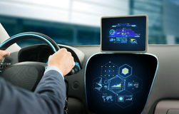 Close up of man driving car with navigation system. Transport, destination, modern technology and people concept - close up of man driving car with navigation royalty free stock photo