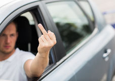 Close up of man driving car showing middle finger Royalty Free Stock Photos