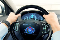Close up of man driving car with volume level icon Stock Photography