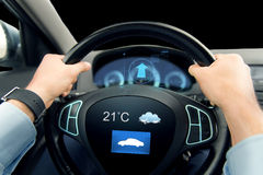 Close up of man driving car with weather sensor Stock Photo