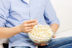 Close up of man eating popcorn at home Stock Images
