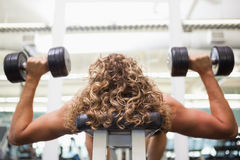 Close up of a man exercising with dumbbells Royalty Free Stock Image
