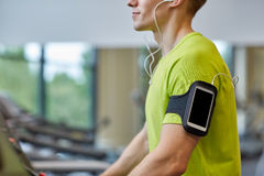 Close up of man exercising on treadmill in gym Royalty Free Stock Image