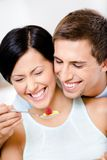 Close-up of man feeding his girlfriend Stock Image