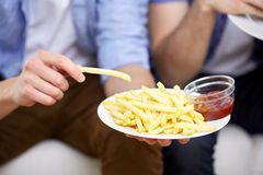 Close up of man with french fries and ketchup Stock Photography