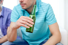 Close up of man friends drinking beer at home Stock Photos