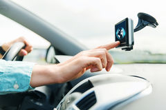 Close up of man with gadget on screen driving car. Transport, business trip, technology, navigation and people concept - close up of male hand using gps royalty free stock photos