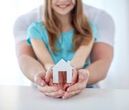 Close up of man and girl hands with paper house Stock Images