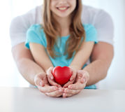 Close up of man and girl holding red heart shape Stock Photos