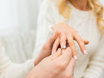 Close up of man giving diamond ring to woman Stock Image