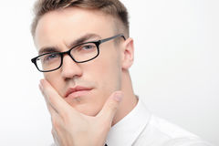 Close-up of man in glasses touching his face Royalty Free Stock Photo
