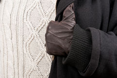 Close-up of man glove, black jacket and knitted sweater. Close-up of man leather glove, black jacket and knitted sweater as winter clothes outfit concept Royalty Free Stock Photos