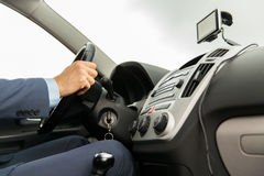 Close up of man with gps navigator driving car. Transport, business trip, technology, navigation and people concept - close up of male hand using gps navigator royalty free stock image