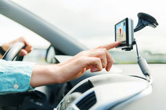 Close up of man with gps navigator driving car. Transport, business trip, technology, navigation and people concept - close up of male hand using gps navigator royalty free stock photo
