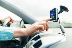 Close up of man with gps navigator driving car. Transport, business trip, technology, navigation and people concept - close up of male hand using gps navigator stock images