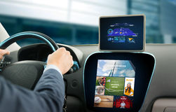 Close up of man with gps on tablet pc driving car Stock Image