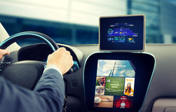 Close up of man with gps on tablet pc driving car Royalty Free Stock Images