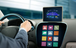 Close up of man with gps on tablet pc driving car Stock Photos