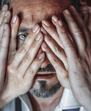 Mans face through the hands / Valentine's Day Royalty Free Stock Image
