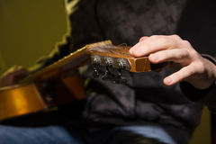 Close-up of a man with a guitar. Stock Images