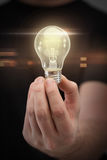 Close up of man hand holding light bulb Stock Photos