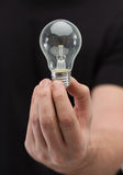 Close up of man hand holding light bulb Royalty Free Stock Images