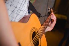 Close up of man hand playing guitar. Royalty Free Stock Photos