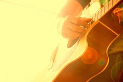 Close up of man hand playing guitar, Vintage filter stock photography