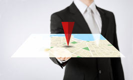 Close up of man hand showing gps navigator map. People, business, navigation, technology and location concept - close up of man hand showing gps navigator map stock illustration