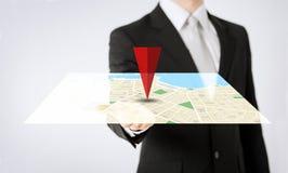 Close up of man hand showing gps navigator map Stock Photos