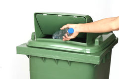 Close up man hand throwing away plastic bottle in recycling bin. Stock Photo