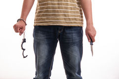Close up of a man handcuffed with a knife in hand Royalty Free Stock Photos
