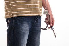 Close up of a man handcuffed with a knife in hand Royalty Free Stock Images