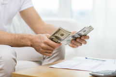 Close up of man hands counting money at home Stock Image