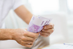 Close up of man hands counting money at home Royalty Free Stock Photography