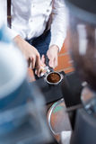 Close-up of man hands with holder pressing coffee Stock Photo