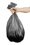 Close up man hands holding black garbage bag. Isolated on white Royalty Free Stock Photo