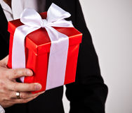 Close up of man hands holding gift box Royalty Free Stock Photography