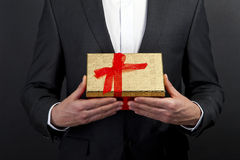 Close up of man hands holding gift box Stock Photo