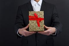 Close up of man hands holding gift box Royalty Free Stock Photo