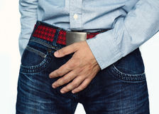 Close up of a man with hands holding his crotch Royalty Free Stock Image