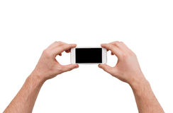 Close up of man hands holding smartphone Royalty Free Stock Images