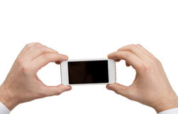 Close up of man hands holding smartphone Stock Photography